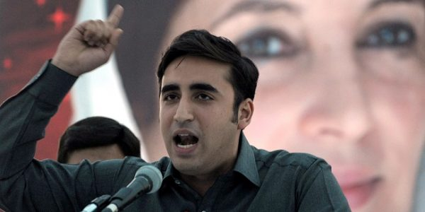 Chairman of Pakistan Peoples Party, Bilawal Bhutto Zardari addresses supporters in front of a poster of slain prime minister Benazir Bhutto at a rally in Karachi on November 30, 2013. Bilawal Bhutto Zardari, the novice head of slain prime minister Benazir Bhutto's party lashed out at the Nawaz Sharif government for its privatisation plans and vowed to resist it.   AFP PHOTO/Rizwan TABASSUM        (Photo credit should read RIZWAN TABASSUM/AFP/Getty Images)