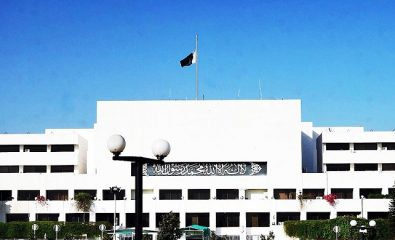 Px15-051 ISLAMABAD: May15 – National flag is seen hoisted at half mast on the building of Parliament House during mourning on the deaths of more than 230 persons in a coalmine incident in Turkey. ONLINE PHOTO by Muhammad Asim